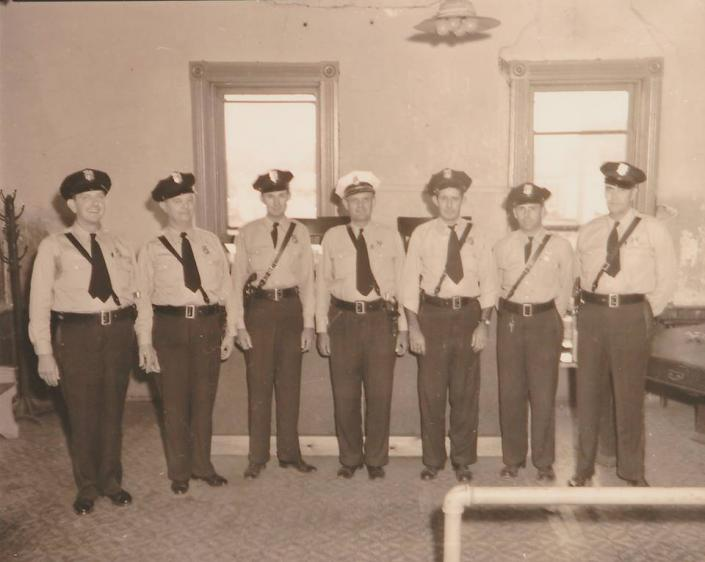 [Image: This is a documented photo of Paragould's police department members around 1950.]